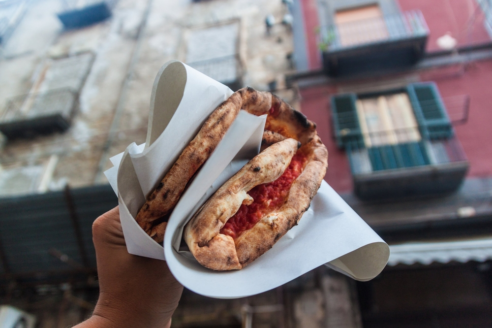 Street food pizza in Naples, original style of pizza.